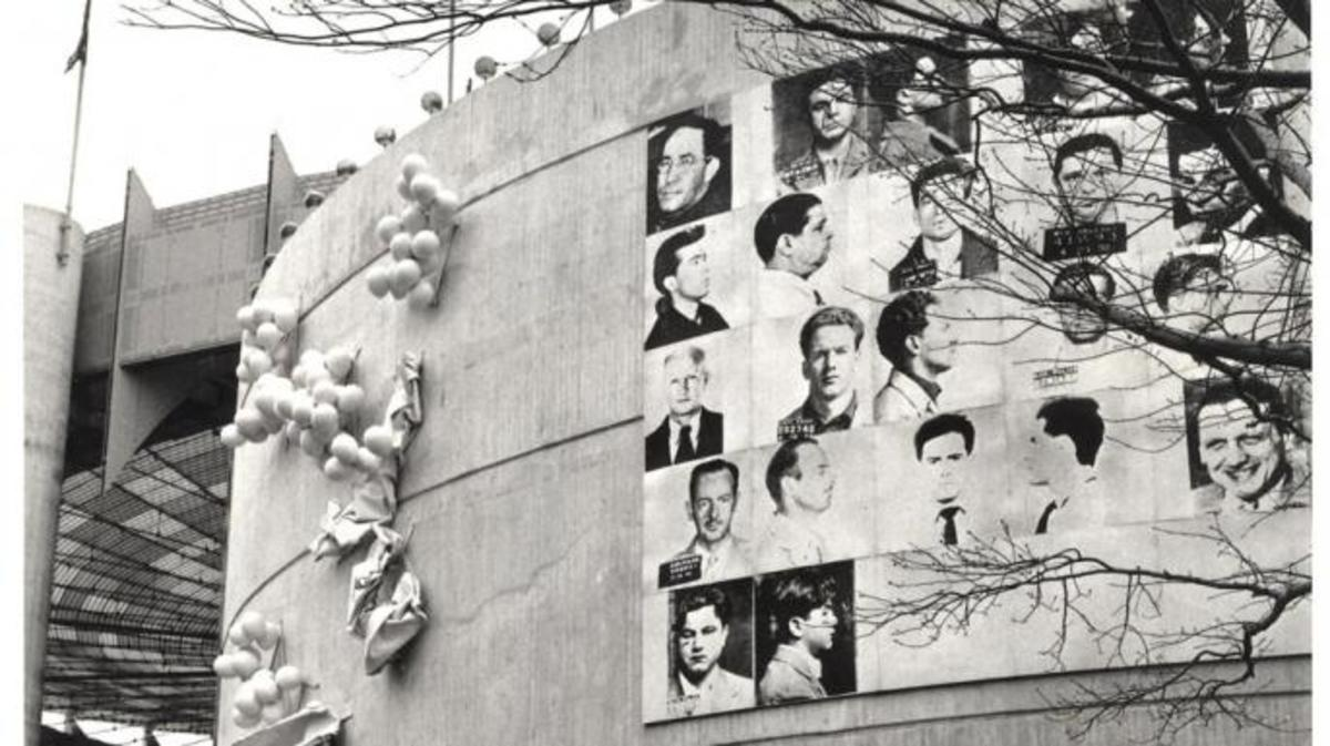 "Andy Warhol's ""13 Most Wanted Men"" hanging outside the New York State Pavillion at the 1964 World's Fair."