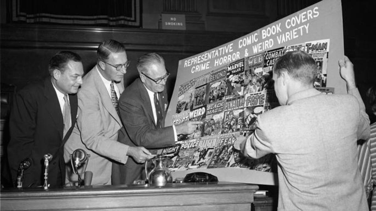 Senators Thomas D. Hennings, Estes Kefauver, Robert C. Hendrickson and Ricard Clendenen, look over sample covers of comic books at a New York hearing of a Senate sub-committee.