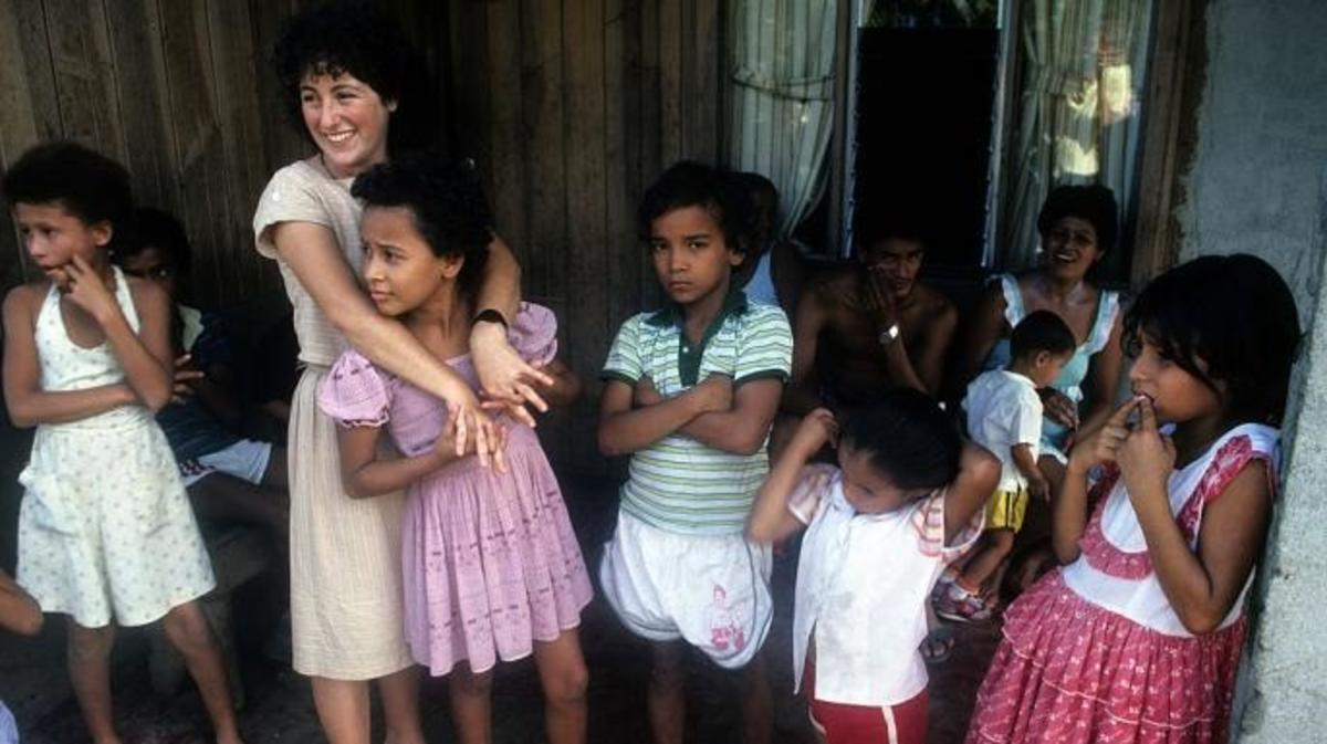 A Peace Corps volunteer and children in Costa Rica, c. 1985.