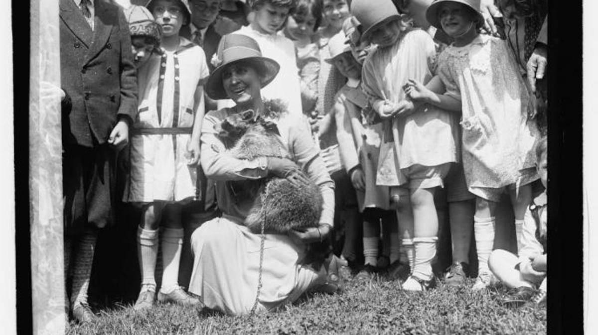 Mrs. Coolidge and Rebecca the raccoon, Easter egg rolling, 1927.