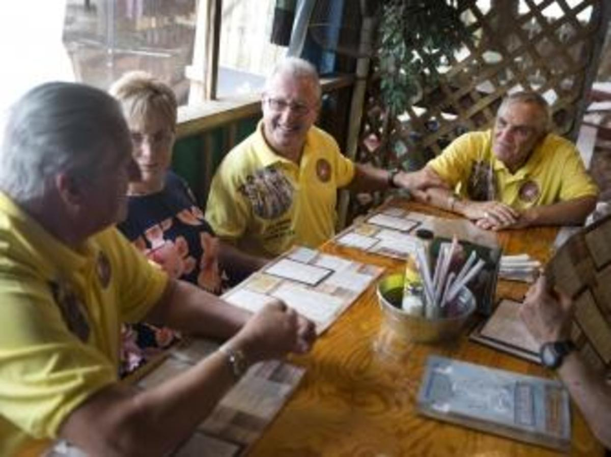 After recreating the photo on Cinnamon Beach the four, plus Dennis' wife Joanne, all went out to lunch.  (Credit: Naples Daily News)