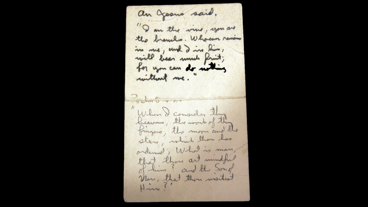 A handwritten card containing a Bible verse that Buzz Aldrin planned to broadcast back to Earth during a lunar Holy Communion service, featured in a space-related auction in Dallas, Texas, 2007. (Credit: LM Otero/AP Photo)