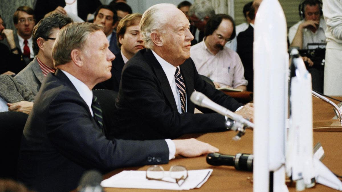 William Rogers, right, chairman of the presidential commission investigating the shuttle Challenger accident, testifing before the Senate Science, Technology and Space subcommittee on Capitol Hill in Washington. (Credit: Scott Stewart/AP Photo)