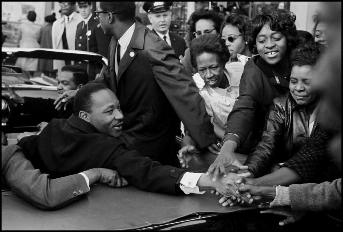 Dr. Martin Luther King, Jr. being greeted on his return to the US after receiving the Nobel Peace Prize, October 31, 1964. (Credit: Leonard Freed/Magnum)