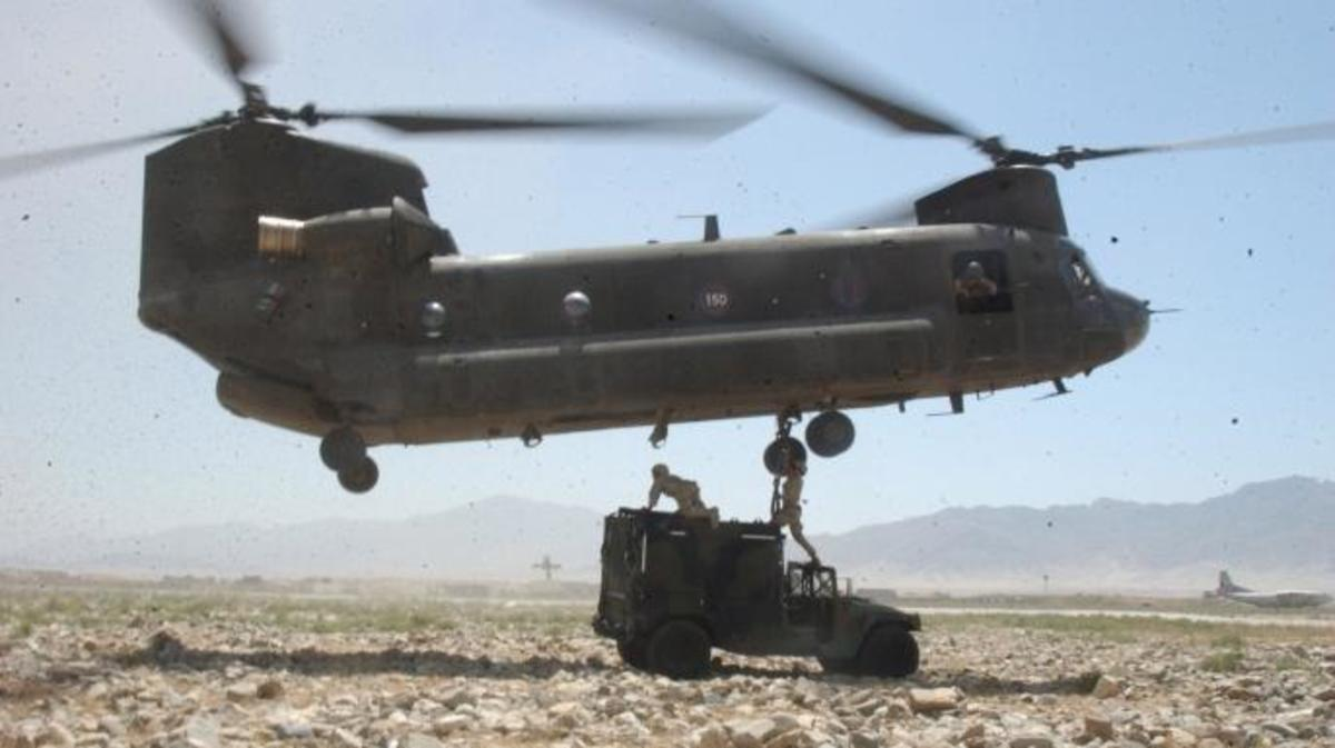U.S. Army soldiers prepare a Humvee to be sling-loaded by a CH-47 Chinook helicopter in Bagram, Afghanistan, on July 24, 2004. (Credit: Public Domain)