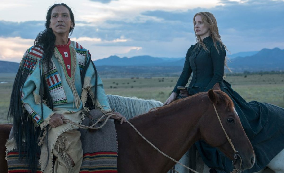 "Michael Greyeyes as Sitting Bull and Jessica Chastain as Caroline Weldon in the movie ""Woman Walks Ahead."" (Credit: Richard Foreman Jr./A24/Everett)"