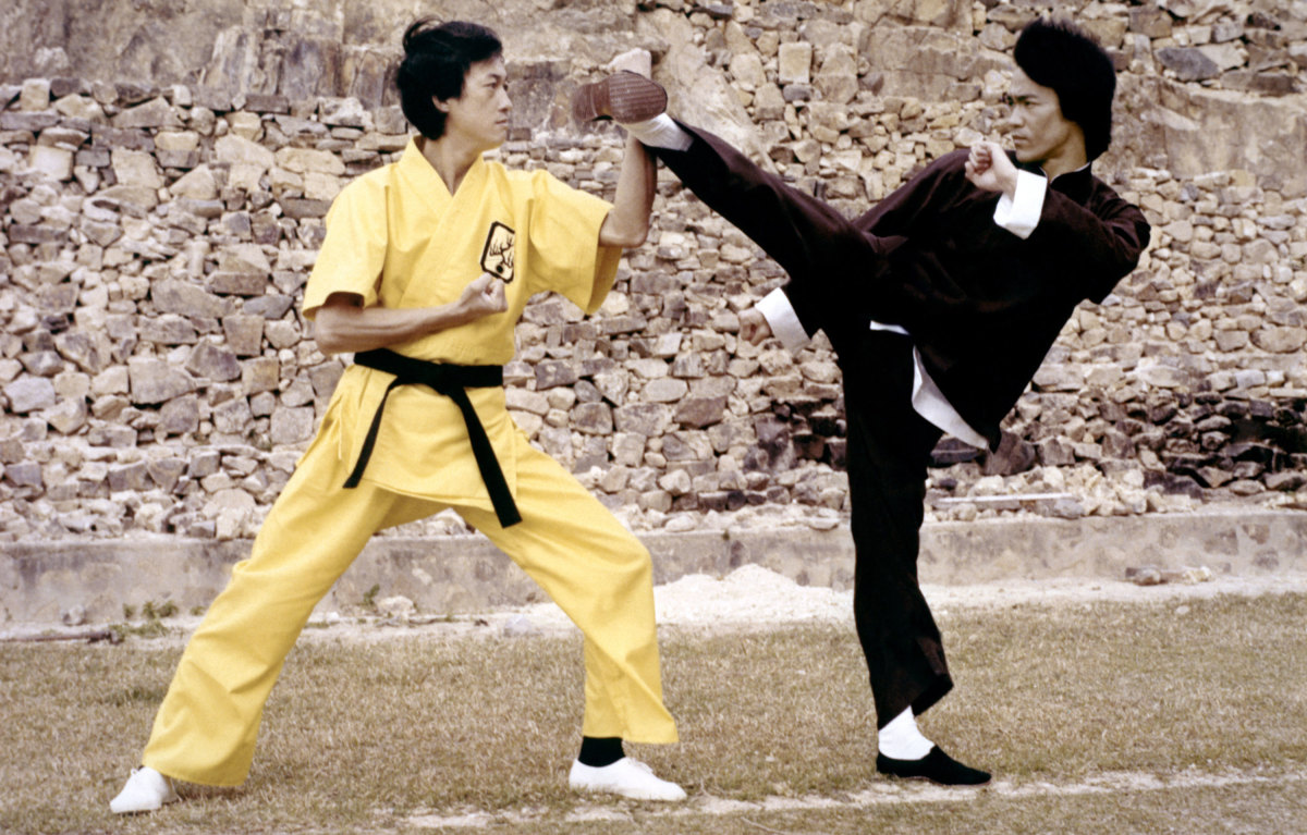 Bruce Lee, right, on the set of Enter the Dragon.