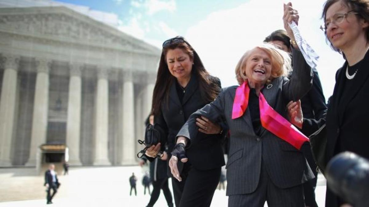 Edith Windsor, 83, acknowledges her supporters as she leaves the Supreme Court March 27, 2013 in Washington, DC. The Supreme Court heard oral arguments in the case 'Edith Schlain Windsor, in Her Capacity as Executor of the Estate of Thea Clara Spyer, Petitioner v. United States,' which challenges the constitutionality of the Defense of Marriage Act (DOMA).  (Credit: Chip Somodevilla/Getty Images)