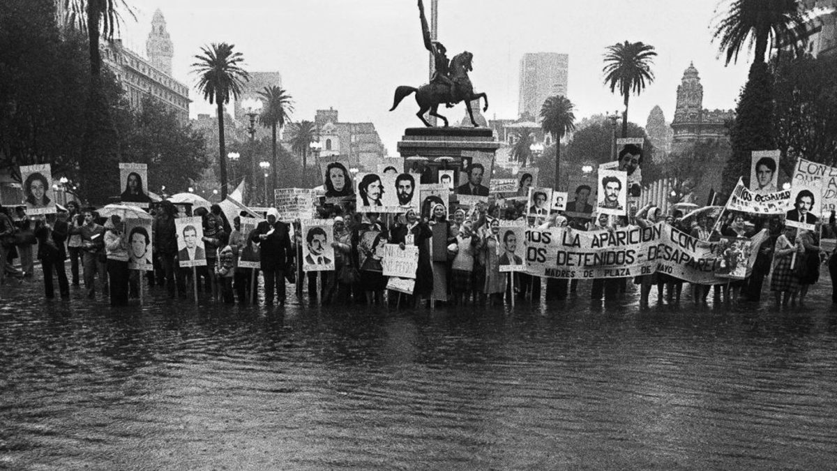 Argentinian people rallying for their missing sons and daughters in Buenos Aires, circa 1980. According to human-rights organizations, about 30,000 people disappeared in Argentina during the military dictatorship that ruled between 1976 and 1983. (Credit: Daniel Garcia/AFP/Getty Images)