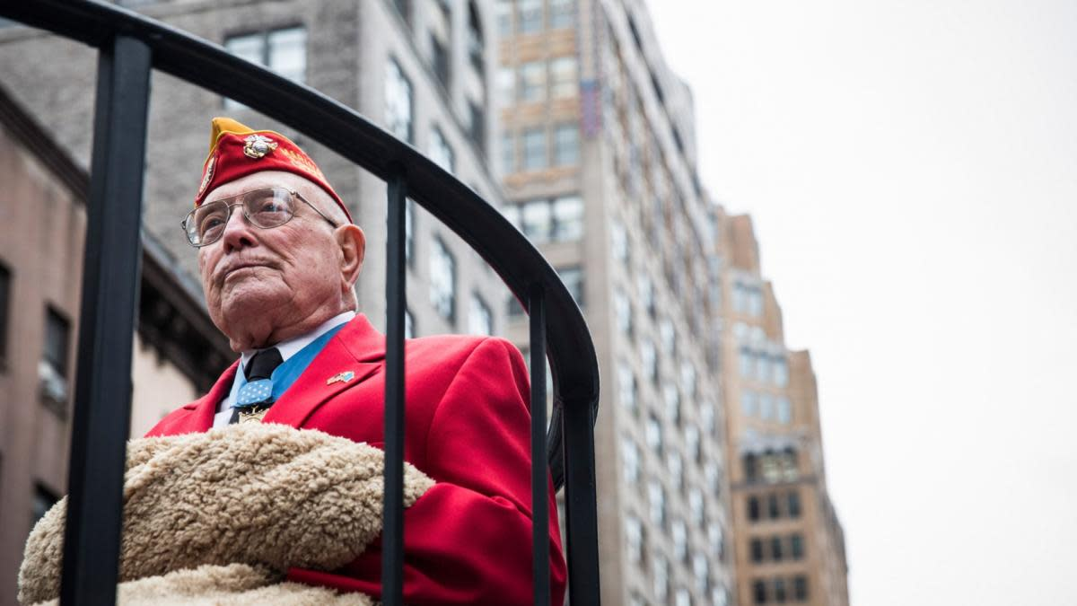 "United States Marine Hershel ""Woody"" Williams riding on a float during the Veteran's Day Parade in New York City, 2013. (Credit:  Andrew Burton/Getty Images)"