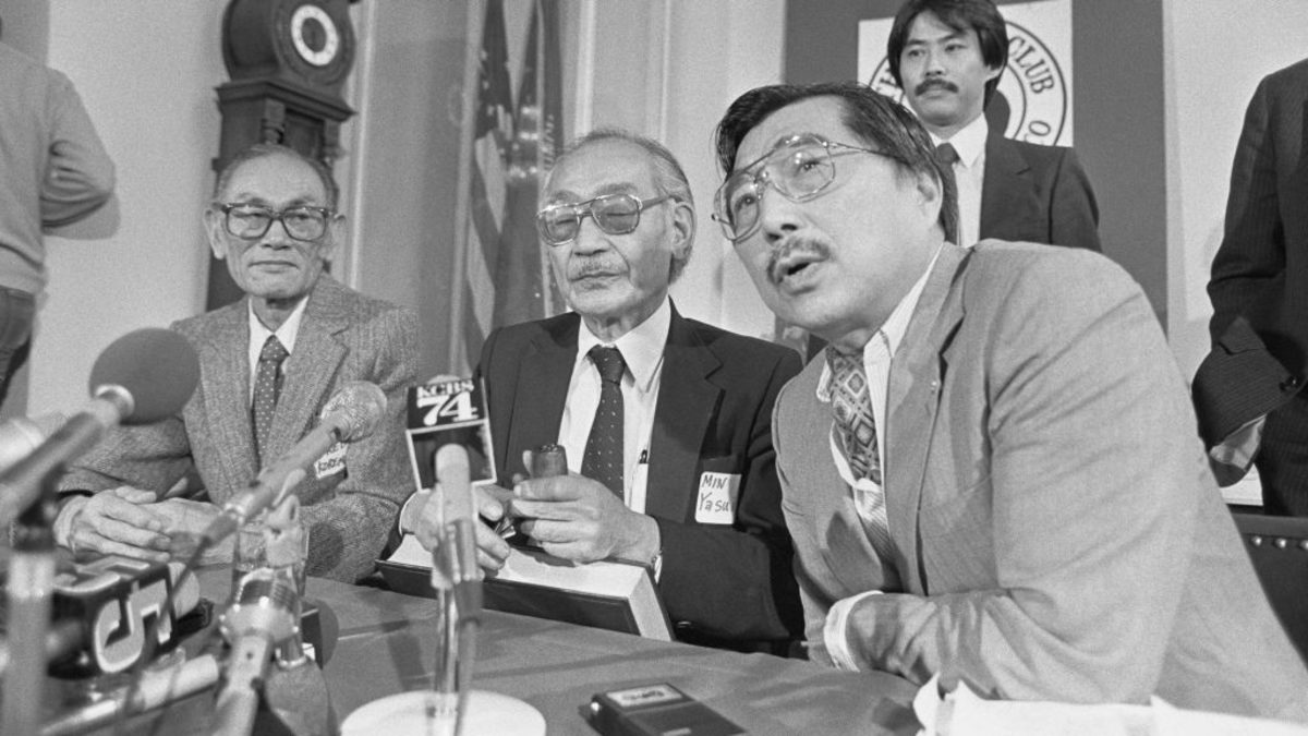 Shown at a 1983 press conference here are Fred Korematsu, (left), Minoru Yasui, center, and Gordon Hirabayashi, right. The three men were petitioning to re-open their cases against the U.S. government for the evacuation of 120,000 Japanese-Americans to internment camps during World War II. (Credit: Bettmann Archive/Getty Images)