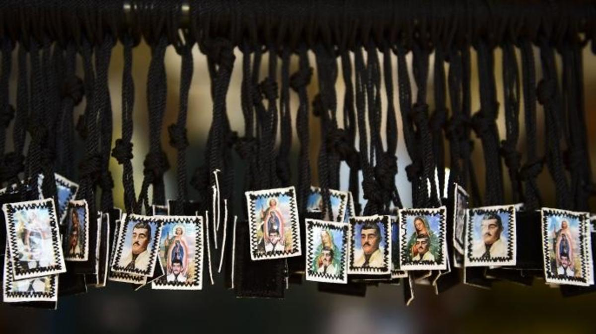 View of scapulars depicting Jesus Malverde, who according to legend was a Robin Hood-type bandit who stole from the rich and gave to the poor. (Credit: RONALDO SCHEMIDT/AFP/Getty Images)