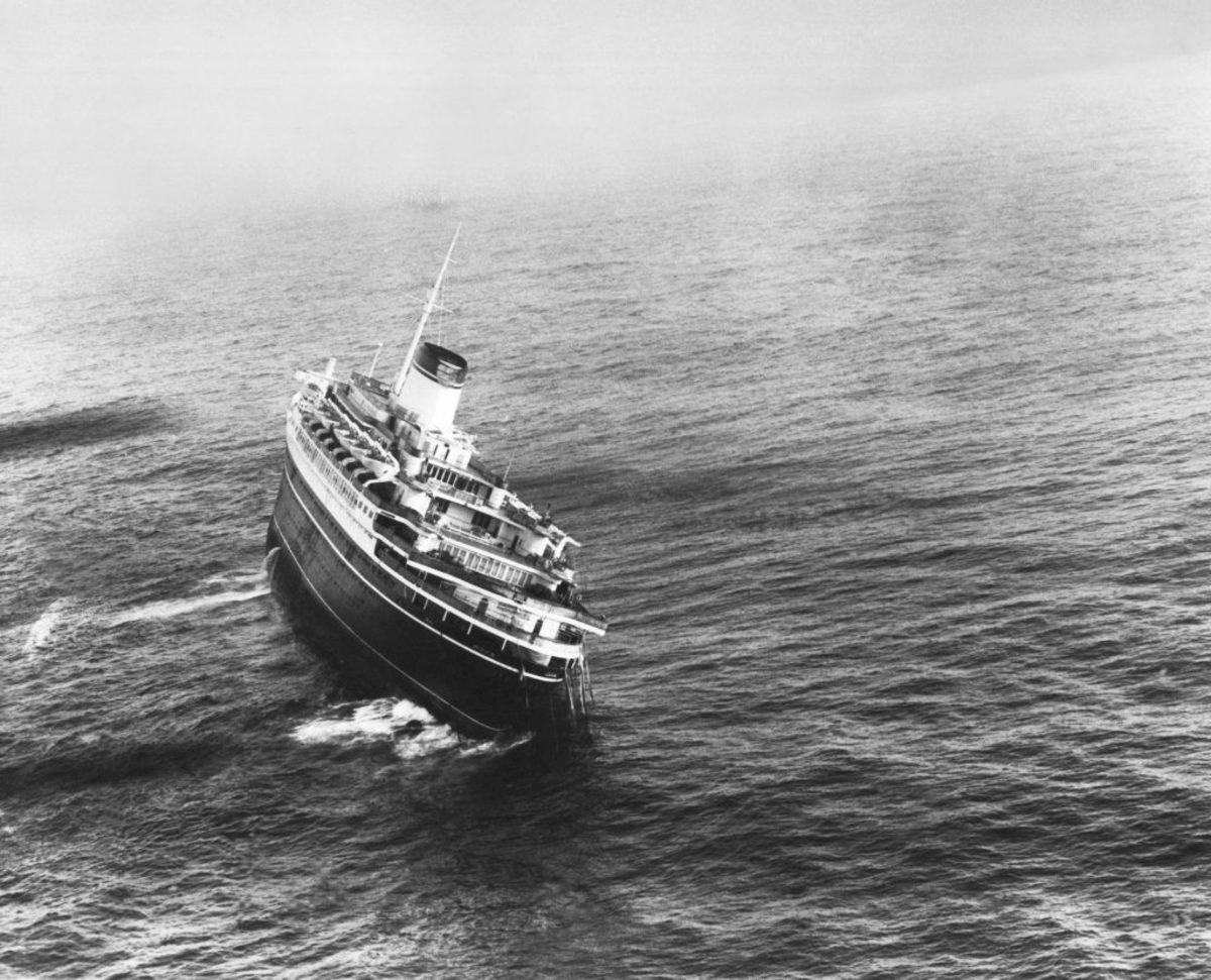 The Italian liner SS Andrea Doria, which had collided with the Swedish liner MS Stockholm off the coast of Nantucket Island, Massachusetts, July 26, 1956. Note the lifeboats on the port side which could not be lowered and used because of the list to starboard. The ship sank shortly after this photo was taken. (Photo by Underwood Archives/Getty Images)