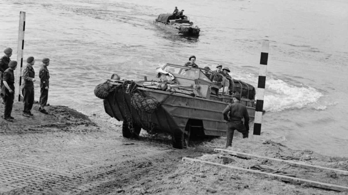 The British Army crossing the Rhine River in Germany, 1945. (Credit: Sgt. Harrison/IWM/Getty Images)