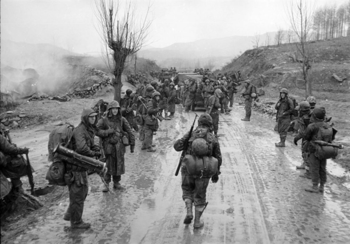 View of U.S. troops as they march through a village, South Korea, 1951. (Photo by Carl Mydans/The LIFE Picture Collection/Getty Images)