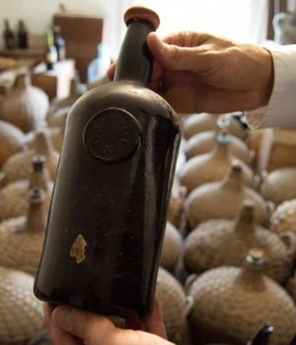A six-month restoration project at Liberty Hall Museum in Union, N.J., uncovered three cases of Madeira wine dating to 1796 and about 42 demijohns from the 1820s while restoring its wine cellar. (Credit: David J. Del Grande/NJ Advance Media via AP)
