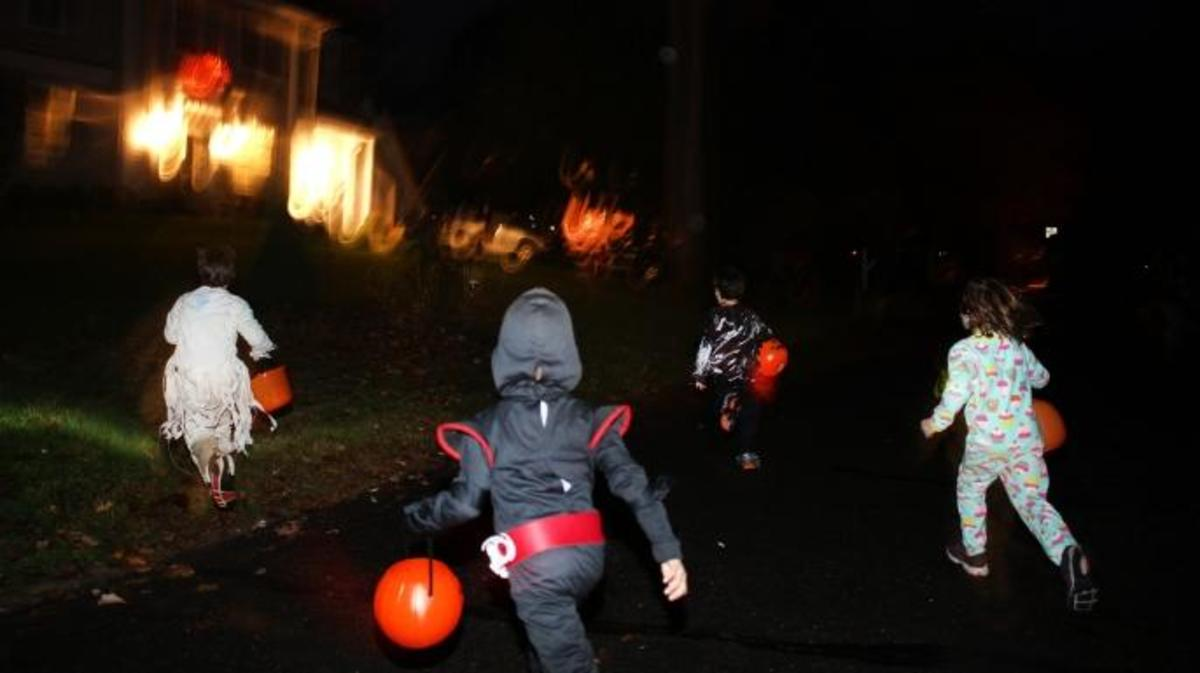 Children trick or treating on Halloween night. (Credit: Tim Clayton/Corbis via Getty Images)