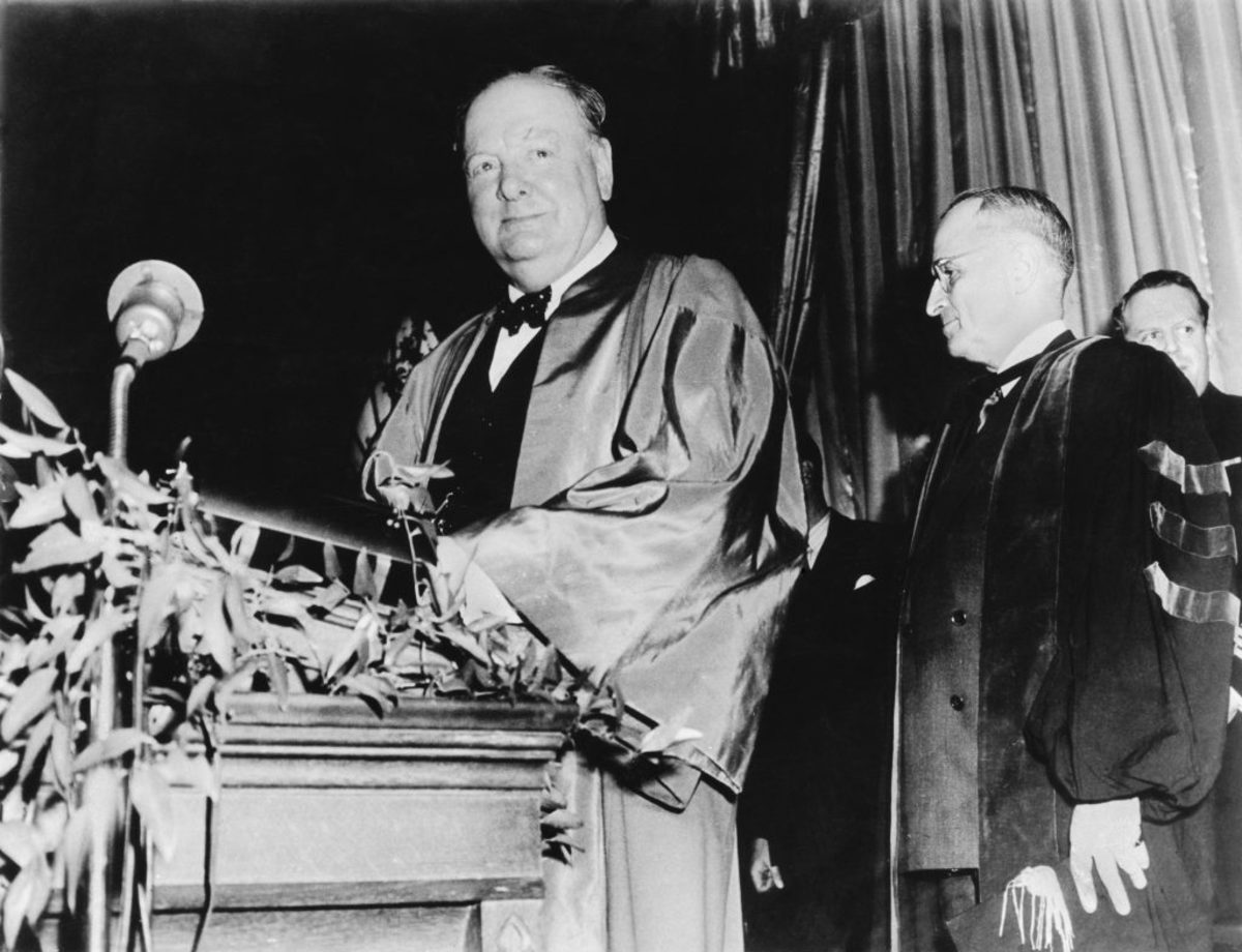 British statesman Winston Churchill, left, preparing to give his 'Sinews of Peace' address, best known for Churchill's use of the term 'Iron Curtain' in the context of Soviet-dominated Eastern Europe. On the right is U.S. President Harry Truman. (Photo by Popperfoto/Getty Images)