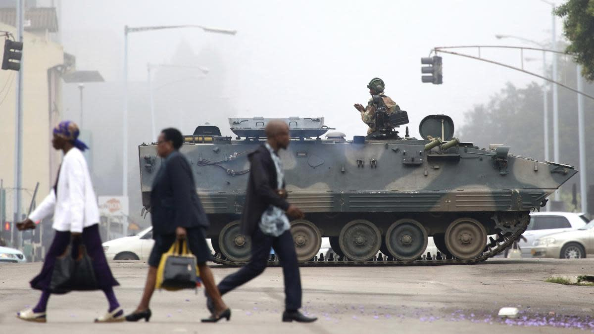An armed soldier patrols a street in Harare, Zimbabwe on November 15, 2017. Zimbabwe's army said it has President Robert Mugabe and his wife in custody and is securing government offices and patrolling the capital's streets following a night of unrest that included a military takeover of the state broadcaster. (Credit: AP Photo)