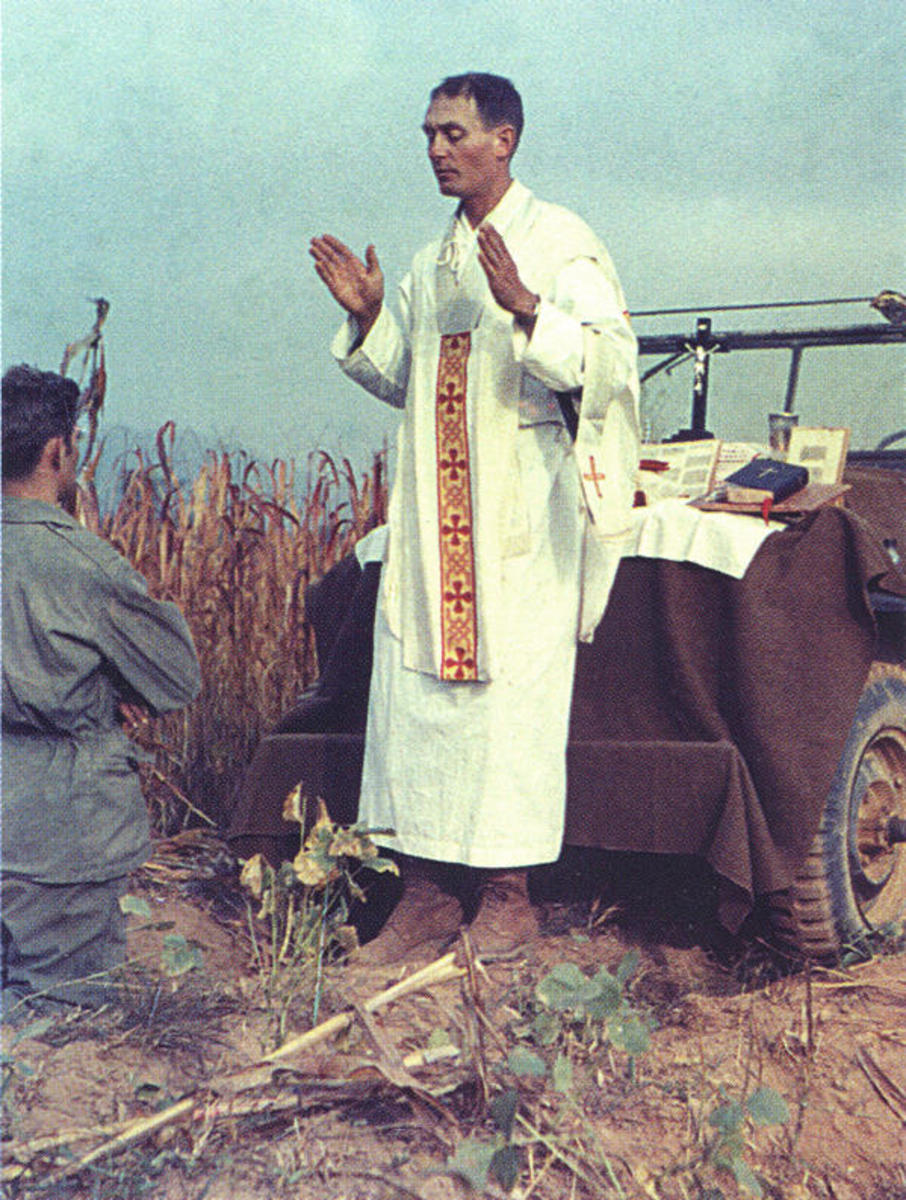 Father Emil Kapaun saying Mass using the hood of a battlefield jeep as an altar. (Credit: The Wichita Diocese)