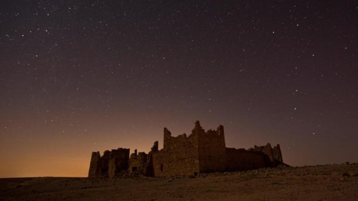 Ancient Roman built fortress Qasr Bashir under stars.