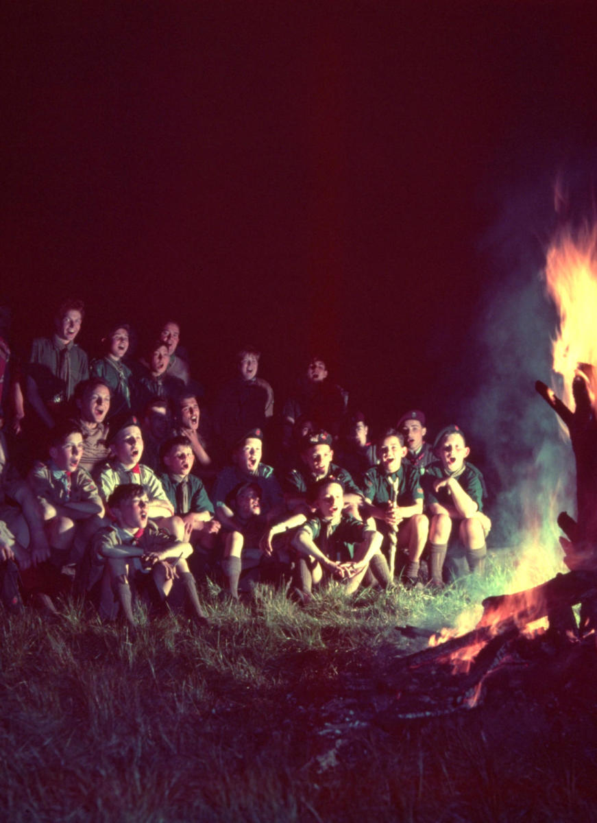 Scouts singing round the camp-fire. (Credit: Alex Dellow/Getty Images)