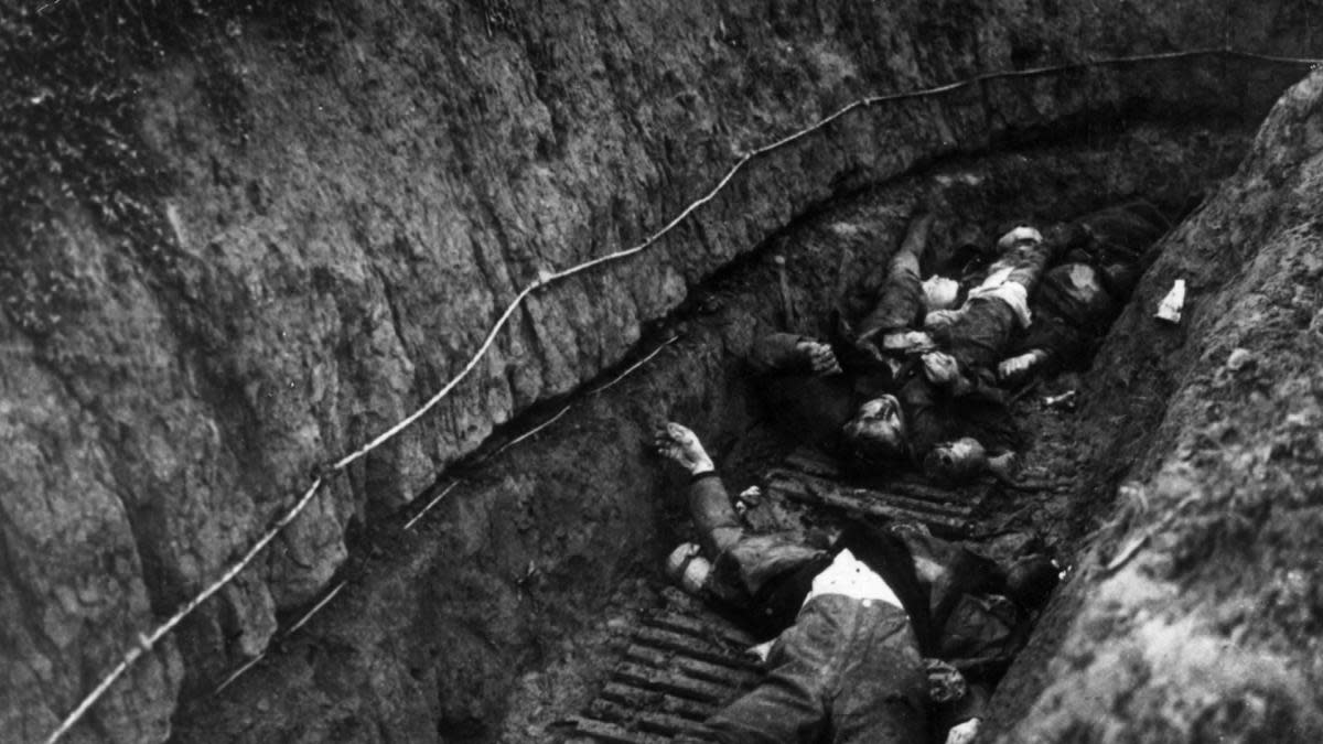 German soldiers lying dead in a trench after the Battle of Cambrai, 1917. (Credit: Hulton Archive/Getty Images)