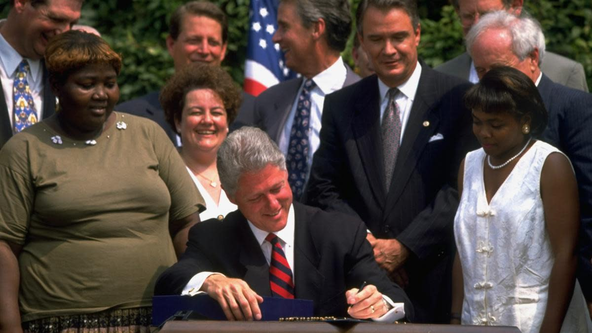 President Bill Clinton signing the welfare reform bill, 1994.