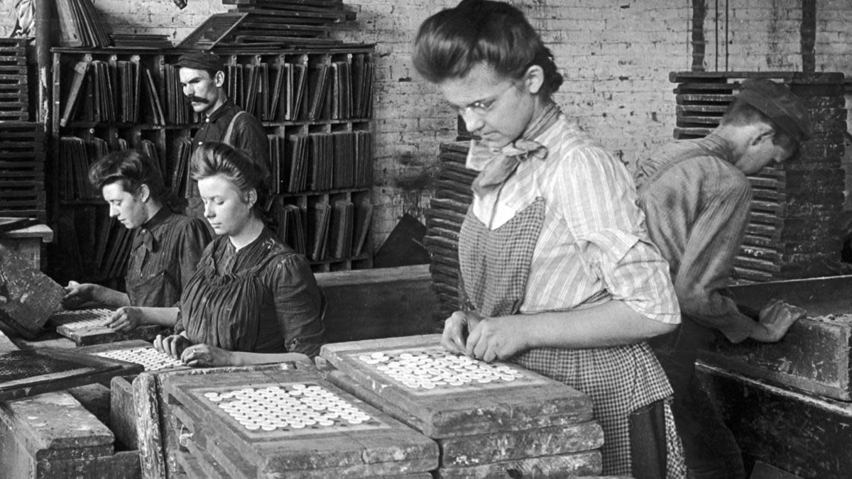Workers at a button factory in New York, circa 1935. (Credit: FPG/Hulton Archive/Getty Images)