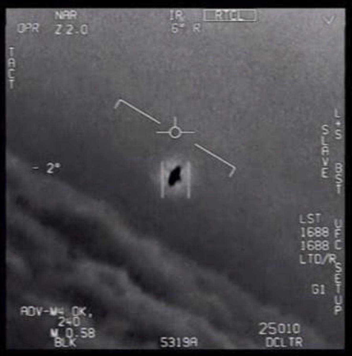 An image taken from a video released by the Defense Department's Advanced Aerospace Threat Identification Program of a 2004 encounter near San Diego between two Navy F/A-18F fighter jets and an unknown object. (Credit: U.S. Department of Defense via The New York Times/Redux)