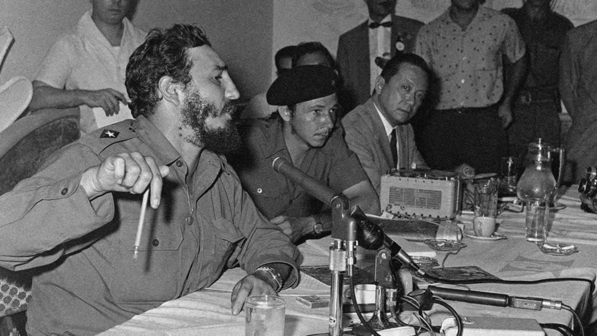 Fidel Castro, with his brother Raul seated next to him, at his first press conference in Havana  July 27, 1959 since resuming the duties of Prime Minister of Cuba. (Credit: AP Photo)