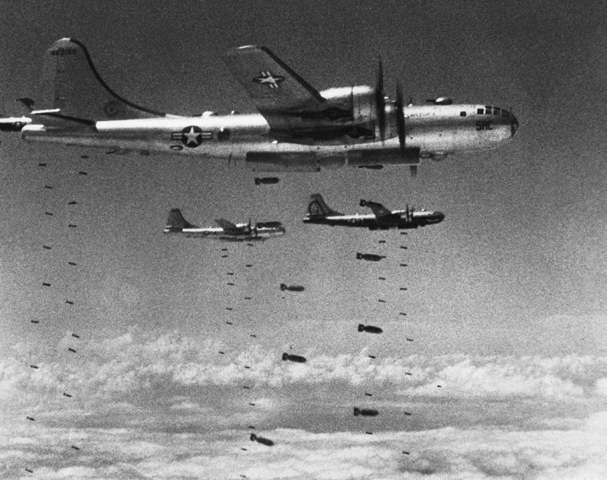 U.S. B-29's dropping bomb loads on North Korean targets during the Korean War. (Credit: Hulton-Deutsch Collection/Corbis/Getty Images)