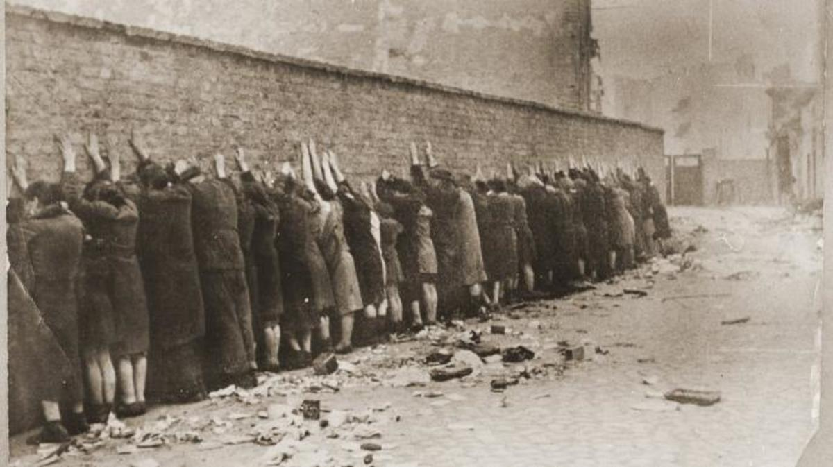 Jews that were captured during the Warsaw Ghetto uprising, about to be searched for weapons. (Credit: United States Holocaust Memorial Museum, courtesy of National Archives and Records Administration, College Park)
