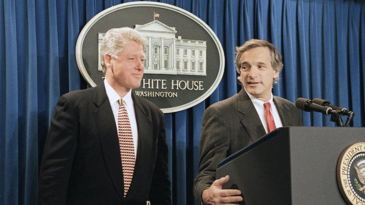 President Bill Clinton looks on as Assistant Secretary of State Robert Gallucci meets reporters in the White House briefing room, October 18, 1994. The president announced that North Korea agreed to freeze its existing nuclear program and accept international inspection of all its nuclear facilities. (Credit: Marcy Nighswander/Getty Images)