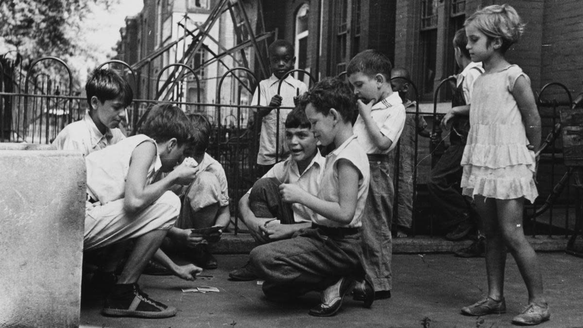 Children playing cards in the front yard in Washington, DC, 1935. (Credit: Smith Collection/Gado/Getty Images)
