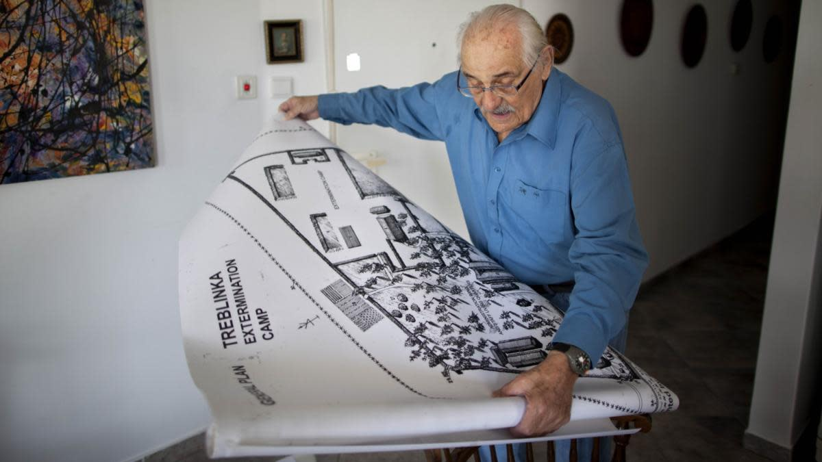 Holocaust survivor Samuel Willenberg displays a map of Treblinka extermination camp during an interview in his home in Tel Aviv, Israel, 2010. (Credit: Oded Balilty/AP Photo)