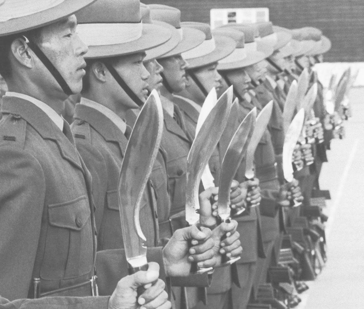 Gurkha troops with Khukuri knives, during a 1971 parade. (Credit: Chris Ware/Keystone/Hulton Archive/Getty Images)
