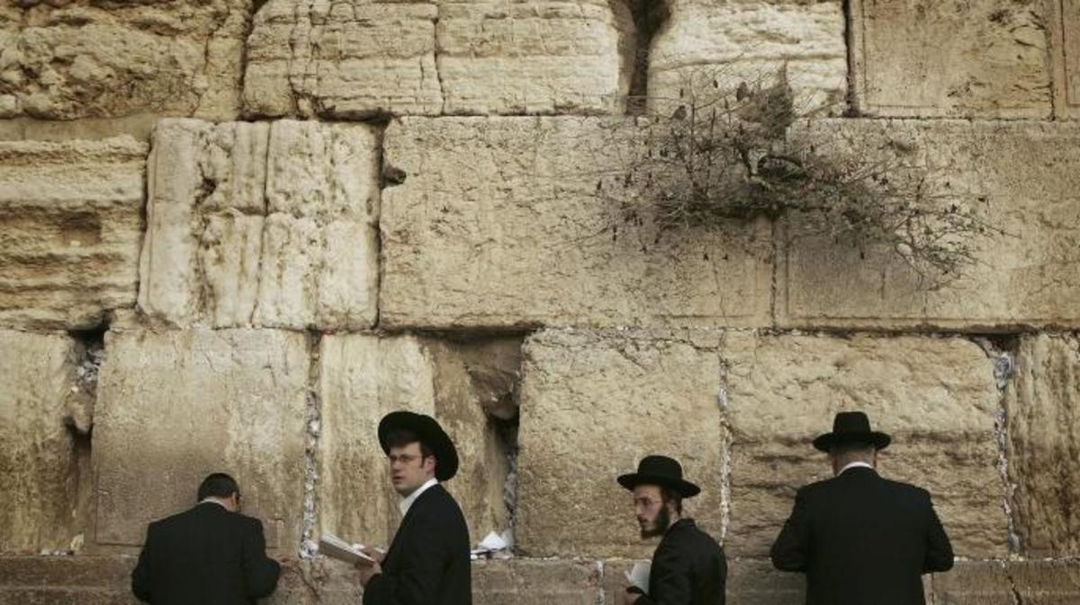 Religious Jewish men praying at The Western Wall, Judaism's holiest site, ahead of the Sabbath, 2005. (Credit: Peter Macdiarmid/Getty Images)