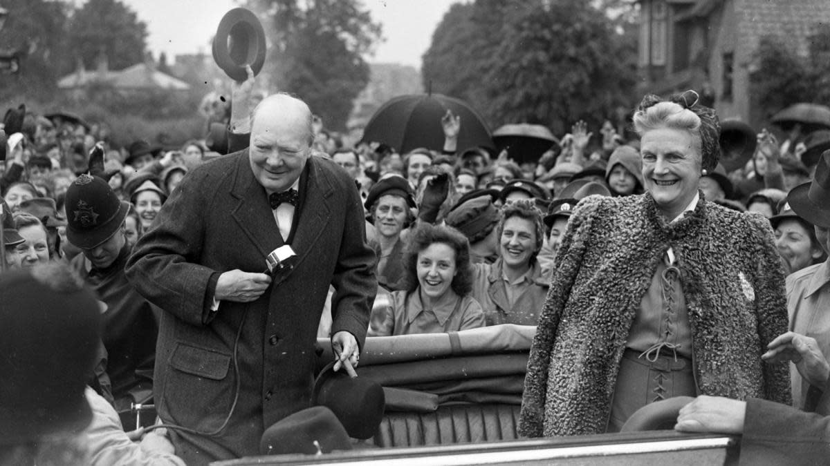 Winston Churchill campaigning with his wife Clementine in his constituency of Woodford. (Credit: PA Images via Getty Images)