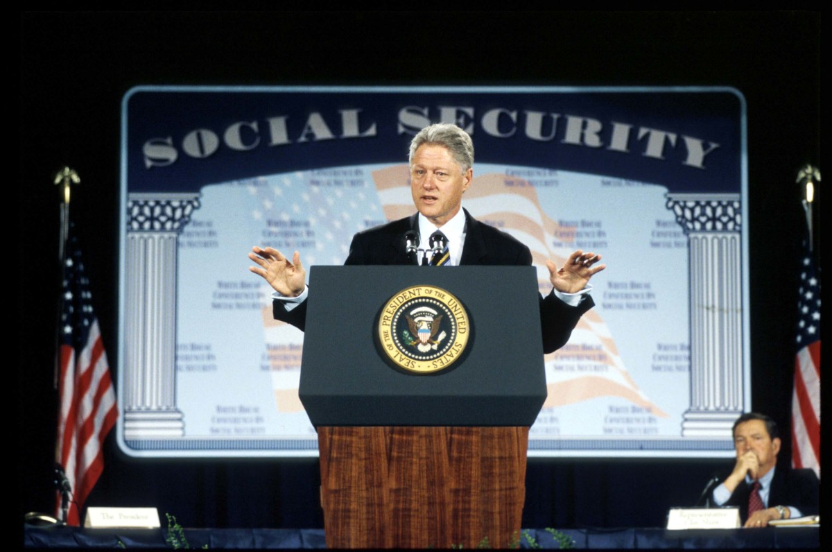 President Bill Clinton addressing a White House conference to discuss ideas about how best to reform Social Security to ensure its solvency well into the 21st century, 1998.