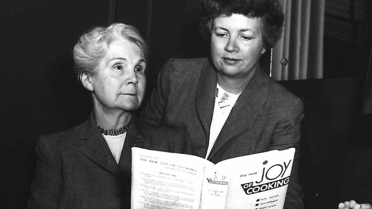 "Marion Rombauer Becker (right) looks over the ""Joy of Cooking"" with her mother Irma Rombauer, in this 1951 photo. (Credit: AP Photo)"