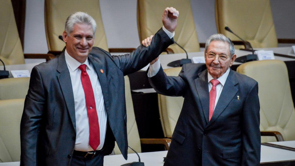 Outgoing Cuban President Raul Castro raises the arm of Cuba's new President Miguel Diaz-Canel after he was formally named by the National Assembly, in Havana on April 19, 2018.(Credit: Adalberto Roque/AFP/Getty Images)