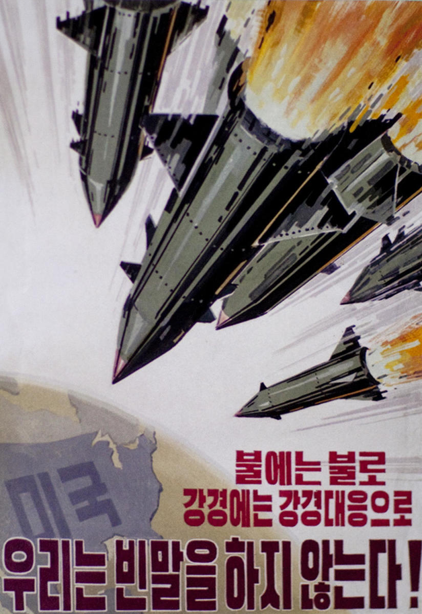 Propaganda poster, with missiles headed towards the U.S., seen in Pyongyang, North Korea, 2010. (Credit: Eric Lafforgue/Art In All Of Us/Corbis/Getty Images)