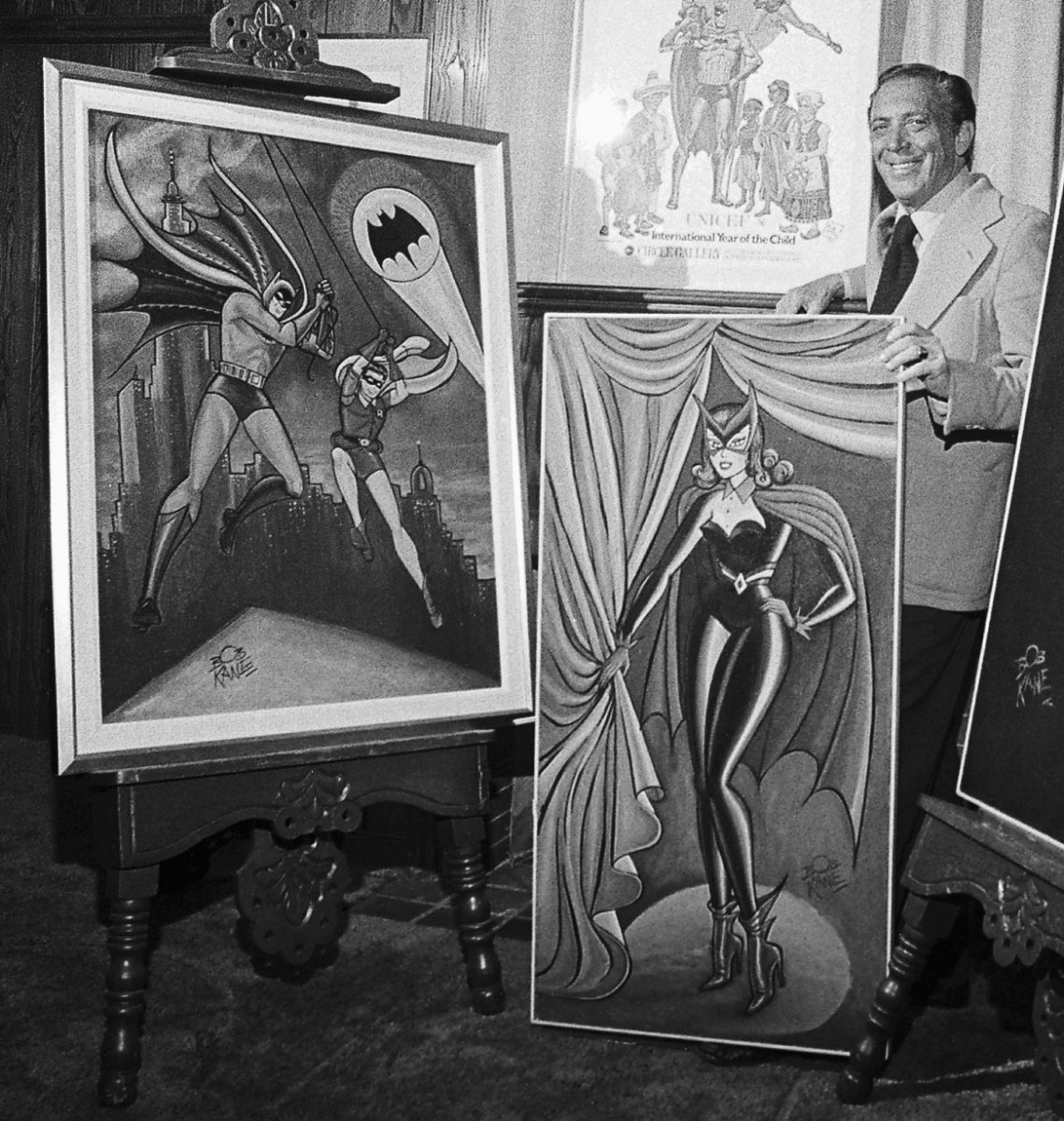 Bob Kane, who created the comic strip character Batman, posing with some of his original drawings of Batman, Robin and Batwoman, in 1979. (Credit: Bettmann Archive/Getty Images)