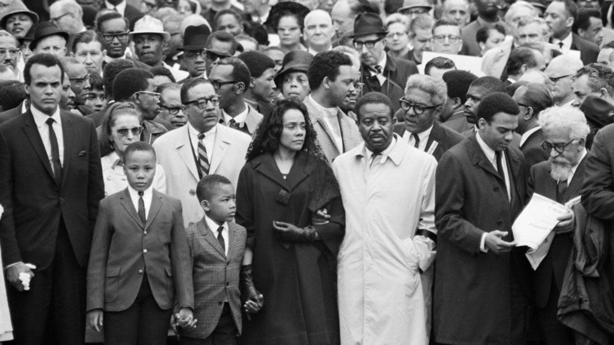 Coretta Scott King, on the arm of Dr. Ralph Abernathy, her husband's successor as head of the Southern Christian Leadership Conference, leads a march of some 10,000 persons in Memphis on April 8th, as a memorial to Dr. Martin Luther King. Jesse Jackson is pictured behind Mrs. King. (Credit: Bettmann Archive/Getty Images)