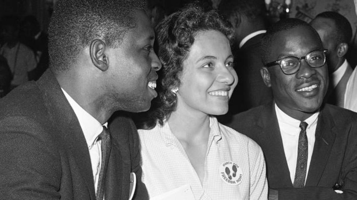 Charles H. Percy, right, chairman of the platform committee of the Republican Party, speaking with Walter Bradford, Diane Nash, and Bernard Lee on July 20, 1960. (Credit: AP Photo)