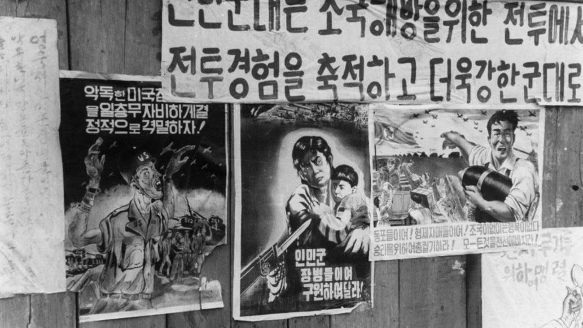 Anti-American propaganda posters put up in a town in the Korean People's Democratic Republic during the Korean War urging people to protect children from American atrocities and to intensify the production of ammunition,1951. (Credit: Sovfoto/UIG/Getty Images)