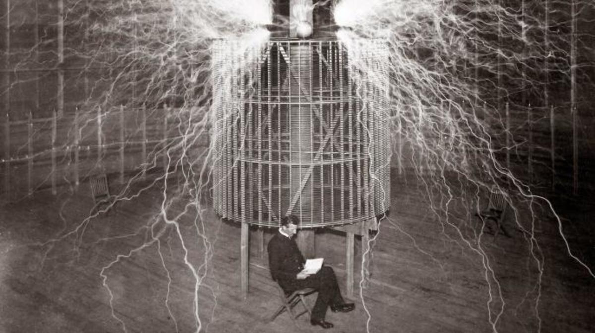 Nilkola Tesla sitting in his Colorado Spring laboratory.