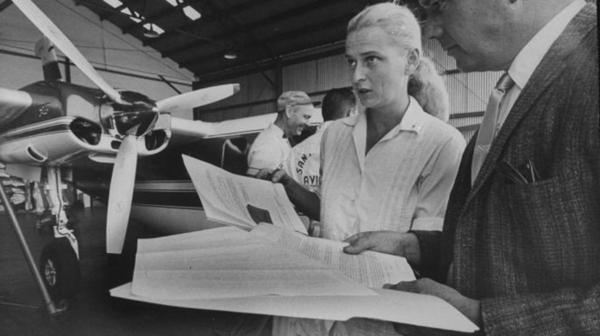 Female astronaut Jerrie Cobb going over preparations for high altitude flight with inspector at North American Aircraft Lab.  (Credit: Bill Bridges/The LIFE Images Collection/Getty Images)