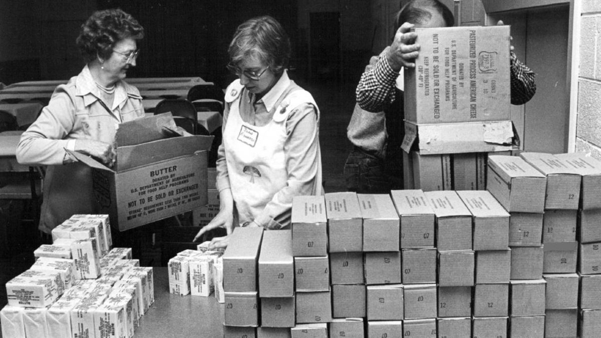 Butter and cheese being stacked and distributed during a surplus of dairy products, circa 1983. (Credit: Dave Buresh/The Denver Post via Getty Images)